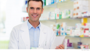 Pharmacist holding a list of prescription drug plan tier pricing